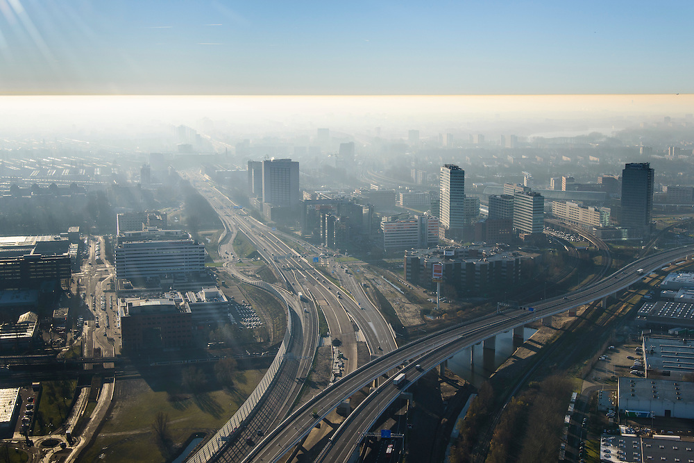 Nederland, Noord-Holland, Amsterdam, 11-12-2013; Amsterdam Sloterdijk, kruising A10 West (Einsteinweg) met A5 (Westrandweg), naar rechts.<br /> De blauwe band in de lucht is het gevolg van inversie (warme luchtlaag boven koude luchtlaag).<br /> Junction of new ringroad Amsterdam. The blue band in the air is a result of inversion (warm air layer above the cold air layer).<br /> luchtfoto (toeslag op standard tarieven);<br /> aerial photo (additional fee required);<br /> copyright foto/photo Siebe Swart
