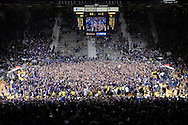 Sports Illustrated -- Kansas State Wildcat fans storm the floor after upsetting the Kansas Jayhawks 84-75 for the first time at home since 1983 at Bramlage Coliseum in Manhattan, Kansas.