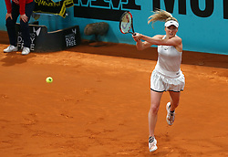 May 8, 2018 - Madrid, Spain - Elina Svitolina of Ukraine plays a backhand to Carla Suarez of Spain in the 2nd Round match during day four of the Mutua Madrid Open tennis tournament at the Caja Magica. (Credit Image: © Manu Reino/SOPA Images via ZUMA Wire)