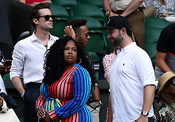 Lewis Hamilton (centre) and Alexis Ohanian in the players box of centre court on day twelve of the Wimbledon Championships at the All England Lawn Tennis and Croquet Club, Wimbledon.