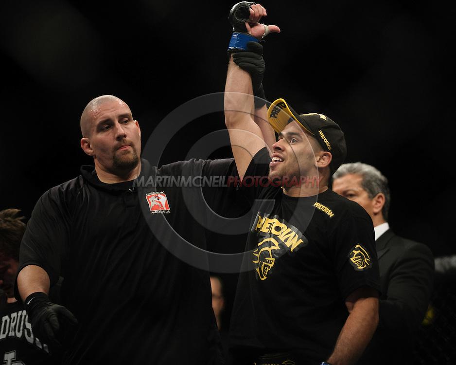 "BIRMINGHAM, ENGLAND, NOVEMBER 5, 2012: Renan Barao is declared the official winner of his fight at ""UFC 138: Munoz vs. Leben"" inside the National Indoor Arena in Birmingham, United Kingdom"