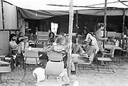 Hippies sitting around under the shade, at Glastonbury, 1989.