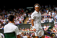 LONDON, ENGLAND - JULY 6: Roger Federer of Switzerland checks if Novak Djokovic of Serbia is ok after his fall during the Gentlemens' Singles final match on day thirteen of the Wimbledon Lawn Tennis Championships at the All England Lawn Tennis and Croquet Club at Wimbledon on July 6, 2014 in London, England.