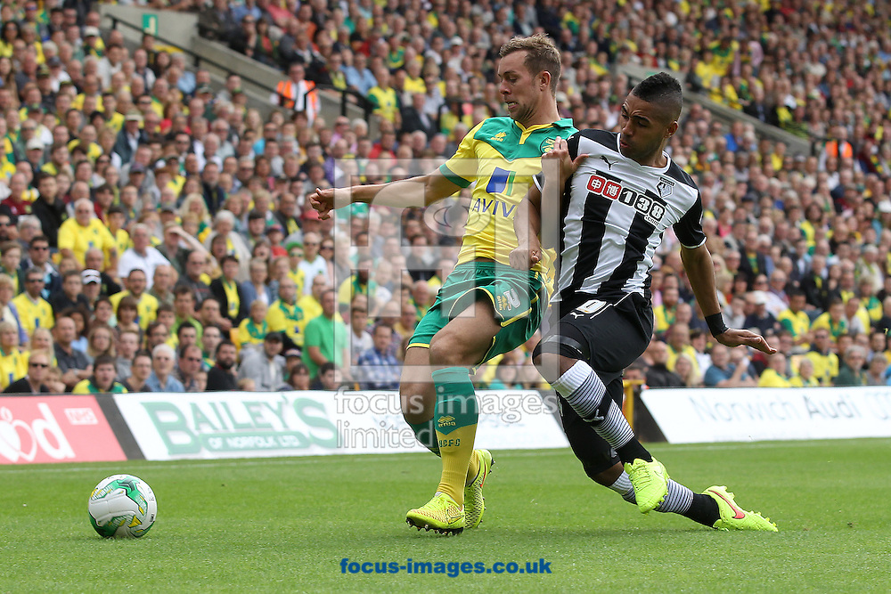 Steven Whittaker of Norwich and Lewis McGugan of Watford in action during the Sky Bet Championship match at Carrow Road, Norwich<br /> Picture by Paul Chesterton/Focus Images Ltd +44 7904 640267<br /> 16/08/2014