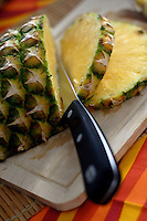 Cutted pineapple on wooden desk
