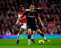 20111227: LONDON, UK - Barclays Premier League 2011/2012: Arsenal vS Wolverhampton Wanderers.<br /> In photo: Nenad Milijas of Wolverhampton Wanderers holds off Alex Song of Arsenal.<br /> PHOTO: CITYFILES