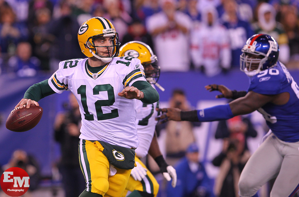 Dec 4, 2011; East Rutherford, NJ, USA; Green Bay Packers quarterback Aaron Rodgers (12) throws a pass during the second half at MetLife Stadium. The Packers defeated the Giants 38-35.