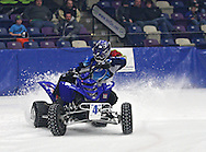 Eric Thorstenson (4x) of Cedar Rapids comes out of turn two during an Unlimited Outlaw Quads heat at the 35th Annual World Championship ICE Racing Series held at the Cedar Rapids Ice Arena at 1100 Rockford Road SW in Cedar Rapids on Saturday evening January 15, 2011.
