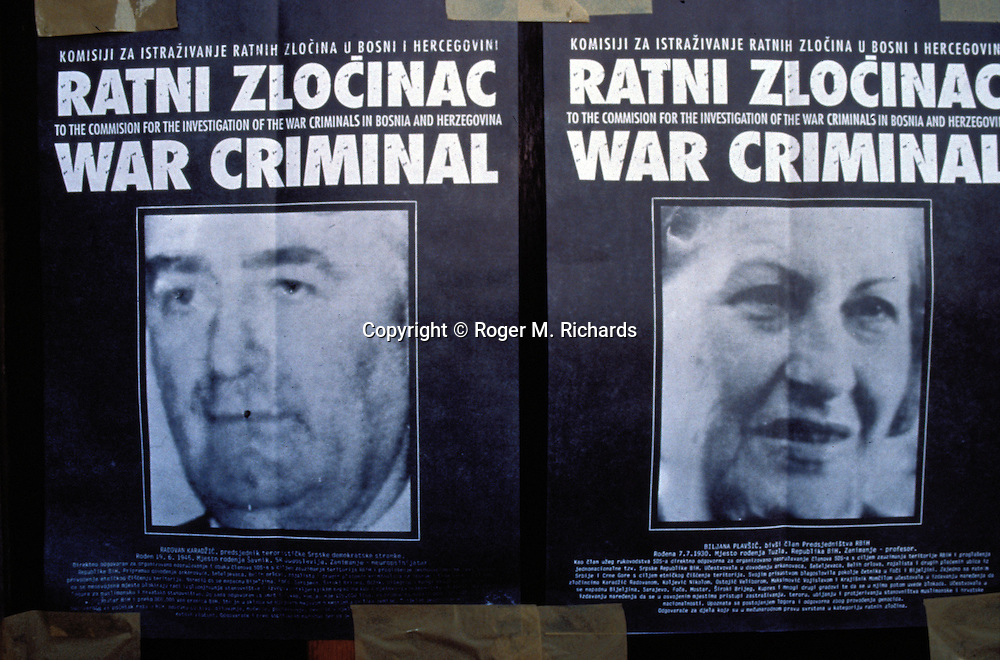 Wanted posters with the images of Bosnian Serb leaders Radovan Karadzic (left) and Biljana Plavsic on a downtown building during the Bosnian Serb siege of Sarajevo, Bosnia and Herzegovina, April 1993. Almost 2,000 children, and over 10,000 people in total were killed in Sarajevo during the 3-1/2 year siege. (Photo by Roger Richards)
