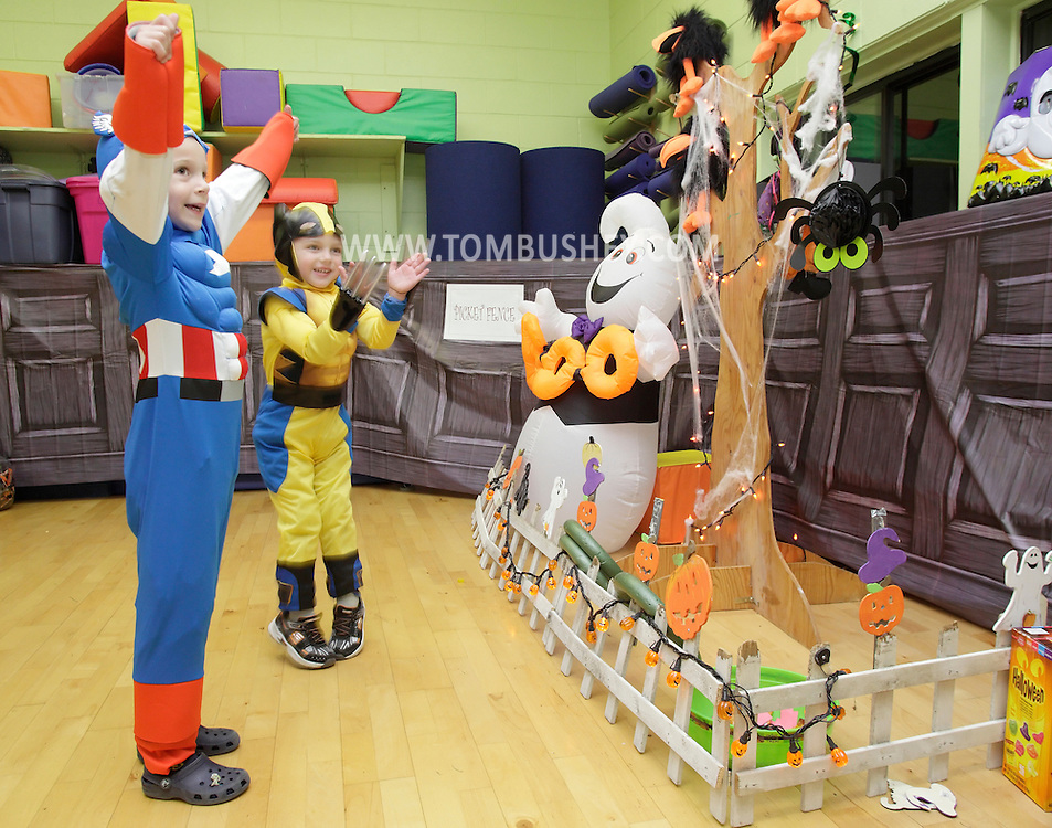 Middletown, New York - Two boys wearing costumes celebrate after winning a game at the Family Fall Festival at the Middletown YMCA on Oct. 23, 2010. ©Tom Bushey / The Image Works