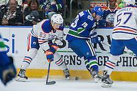 PENTICTON, CANADA - SEPTEMBER 16: Matt Benning #83 of Edmonton Oilers stick checks Danny Moynihan #79 of Vancouver Canucks on September 16, 2016 at the South Okanagan Event Centre in Penticton, British Columbia, Canada.  (Photo by Marissa Baecker/Shoot the Breeze)  *** Local Caption *** Matt Benning; Michael Garteig;