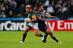 South Africa replacement Schalk Brits beats USA Fly-Half Shalom Suniula  - Mandatory byline: Rogan Thomson/JMP - 07966 386802 - 07/10/2015 - RUGBY UNION - The Stadium, Queen Elizabeth Olympic Park - London, England - South Africa v USA - Rugby World Cup 2015 Pool B.