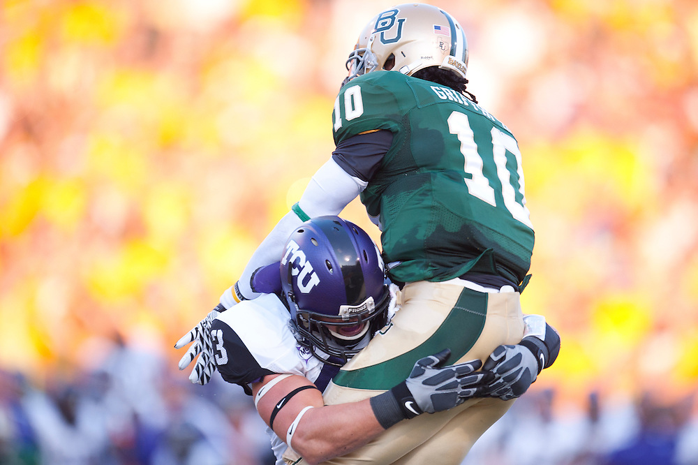 WACO, TX - SEPTEMBER 02: Tank Carder #43 of the TCU Horned Frogs puts a hit on Robert Griffin III #10 the Baylor Bears at Floyd Casey Stadium on September 02, 2011 in Waco, Texas. ( Photo by: Rob Tringali) *** Local Caption *** Tank Carder