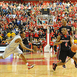 Rutgers Scarlet Knights guard Myles Mack (4) looks to the clock while trying to run time out during Rutgers' 67-60 upset victory over #8 UConn in NCAA Big East Basketball action at the Louis Brown Athletic Center in Piscataway, N.J. on Jan 7, 2012.
