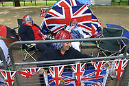 A family who camped out overnight outside Buckingham Palace to secure the best viewing positions for the two-day Golden Jubilee celebrations to mark the 50 year reign of Queen Elizabeth II. Celebrations took place across the United Kingdom with the centrepiece a parade and fireworks at Buckingham Palace, the Queen's London residency. Queen Elizabeth ascended to the British throne in 1952 upon the death of her father, King George VI.