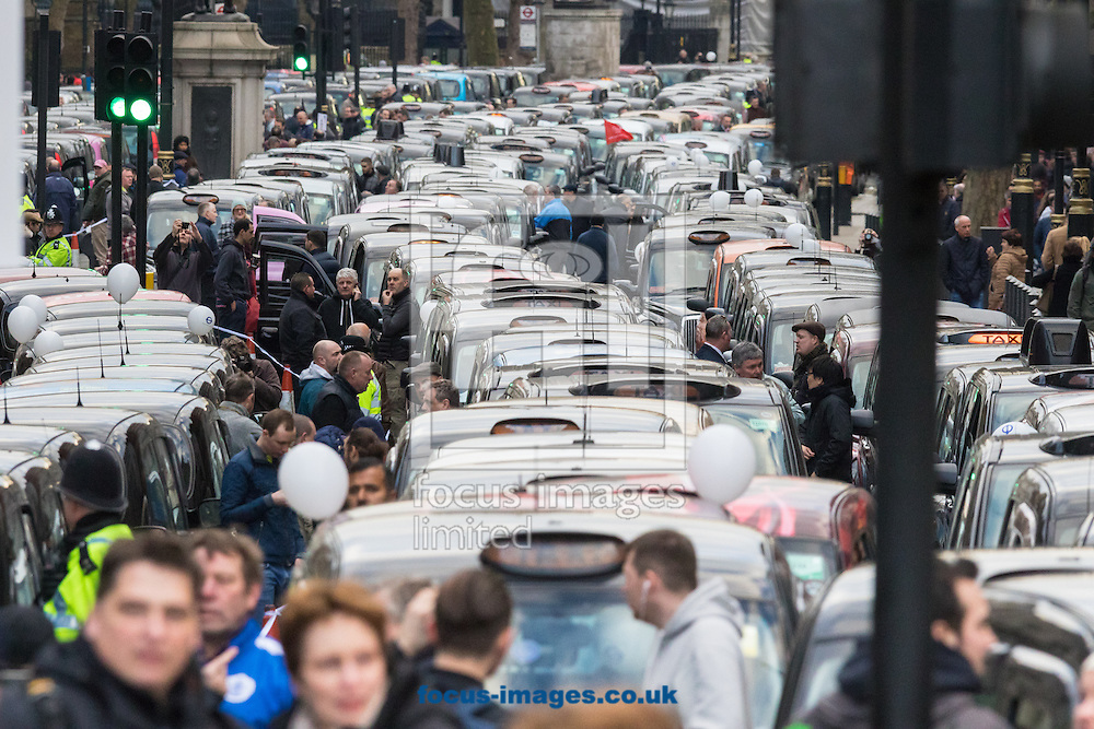 A river of taxis blockade Whitehall as an estimated 8,000 cabbies protest against &quot;unfair competition&quot; from Uber mini cabs<br /> Picture by Paul Davey/Focus Images Ltd +447966 016296<br /> 10/02/2016