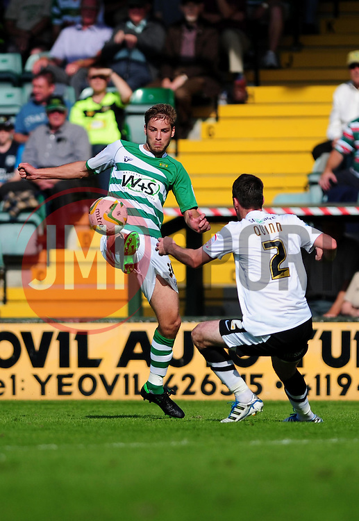 Yeovil Town's Sam Foley controls the ball under pressure from Doncaster Rovers' Paul Quinn - Photo mandatory by-line: Dougie Allward/Josephmeredith.com  - Tel: Mobile:07966 386802 01/09/2012 - SPORT - FOOTBALL - League 1 -  Yeovil  - Huish Park -  Yeovil Town v Doncaster Rovers