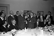 22/06/1965<br /> 06/22/1965<br /> 22 June 1965<br /> Presentation to Mr. Montague at the Shelbourne Hotel, Dublin. At a private dinner in the Shelbourne Hotel, a group of Dublin Businessmen made a presentation to Mr. F.J. Montague, retiring Manager of the O'Connell Street Branch of the Northern Bank Ltd. Picture shows Mr. W. Davidson, (left) Director, Northern Bank Ltd. (Belfast) handling over the gift to Mr. F.J. Montague.