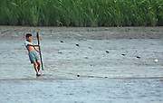 A North Korean boy fishes with a net in the Yalu River next to the town of Sunuiju July 9, 2006. After Pyongyang defied world opinion and test-fired seven missiles last week, Japan formally introduced a U.N. resolution, co-sponsored by the United States, Britain and France, to impose sanctions against its missile program.. DPRK, north korea, china, dandong, border, liaoning, democratic, people's, rebiblic, of, korea, nuclear, test, rice, japan, arms, race, weapons, stalinist, communist, kin jong il