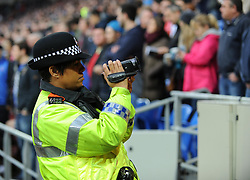 police video Swansea city fans during the game. - Photo mandatory by-line: Alex James/JMP - Tel: Mobile: 07966 386802 03/11/2013 - SPORT - FOOTBALL - The Cardiff City Stadium - Cardiff - Cardiff City v Swansea City - Barclays Premier League
