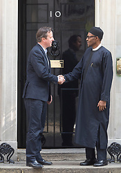 © Licensed to London News Pictures. 23/05/2015. London, UK.British Prime Minister David Cameron greets President of Nigeria, General Muhammadu Buhari, at 10 Downing Street, central London. Photo credit : Isabel Infantes/LNP
