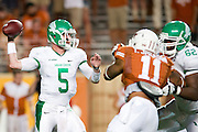 AUSTIN, TX - AUGUST 30:  Andrew McNulty #5 of the North Texas Mean Green drops back to pass against the Texas Longhorns on August 30, 2014 at Darrell K Royal-Texas Memorial Stadium in Austin, Texas.  (Photo by Cooper Neill/Getty Images) *** Local Caption *** Andrew McNulty