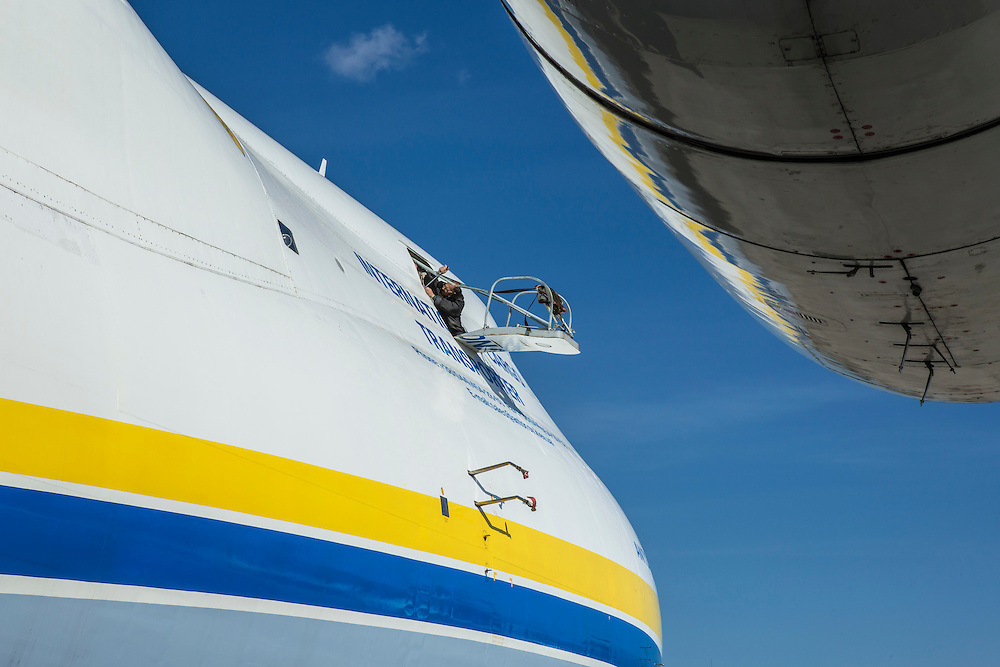 GOSTOMEL, UKRAINE - OCTOBER 1, 2014: A worker performs maintenance on the Antonov AN-225, the longest and heaviest airplane ever built, on an airfield in Gostomel, outside Kiev, Ukraine. CREDIT: Brendan Hoffman for The New York Times