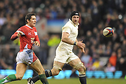 James Hook (Wales) passes as Steve Borthwick (England) looks on during the RBS 6 Nations Championship match between England and Wales at Twickenham Stadium on February 6, 2010 in London, England.