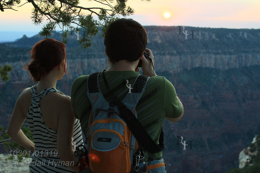 Visitors enjoy sunrise and sunset from Bright Angel Point, North Rim, Grand Canyon National Park, Arizona.