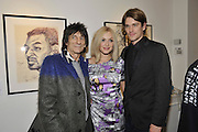 RONNIE WOOD; FEARNE COTTON; JESSE WOOD;, Faces, Time and Places. Symbolic Collection & Ronnie Wood private view, Cork St. London. 8 November 2011.<br /> <br /> <br />  , -DO NOT ARCHIVE-© Copyright Photograph by Dafydd Jones. 248 Clapham Rd. London SW9 0PZ. Tel 0207 820 0771. www.dafjones.com.
