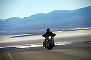 A motorcyclist makes his way along a a desert road in Death Valley National Park, Calif., on Oct. 26, 2012.