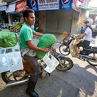 Jan 3, 2013 - Goods of all sorts are transported by two wheels. Here ice blocks are departing for the morning customers in the Cambodian capital city of Phnom Penh.<br /> <br /> Story Summary: Amidst the feverish pace of Phnom Penh&rsquo; city streets, a workhorse of transportation for people and goods emerges: Bicycles, motorcycles, scooters, Mopeds, motodups and Tuk Tuks roam in place of cars and trucks. Almost 90 percent of the vehicles roaming the Cambodian capital of almost 2.3 million people choose these for getting about. Congestion and environment both benefit from the small size and small engines. Business is booming in the movement of goods and and another one million annual tourists in Cambodia&rsquo;s moto culture.