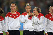 8/21/08 11:28:06 PM -- The 2008 Beijing Summer Olympics -- Beijing, China<br />  -- Team USA's (left to right) Lauren Cheney, Natasha Kai and Heather Mitts wait to receive the gold medals  after their win over Brazil in their Women's Soccer Gold Medal Game Thrusday August 21, 2008. -- <br /> <br /> <br /> Photo by Jeff Swinger, USA TODAY Staff
