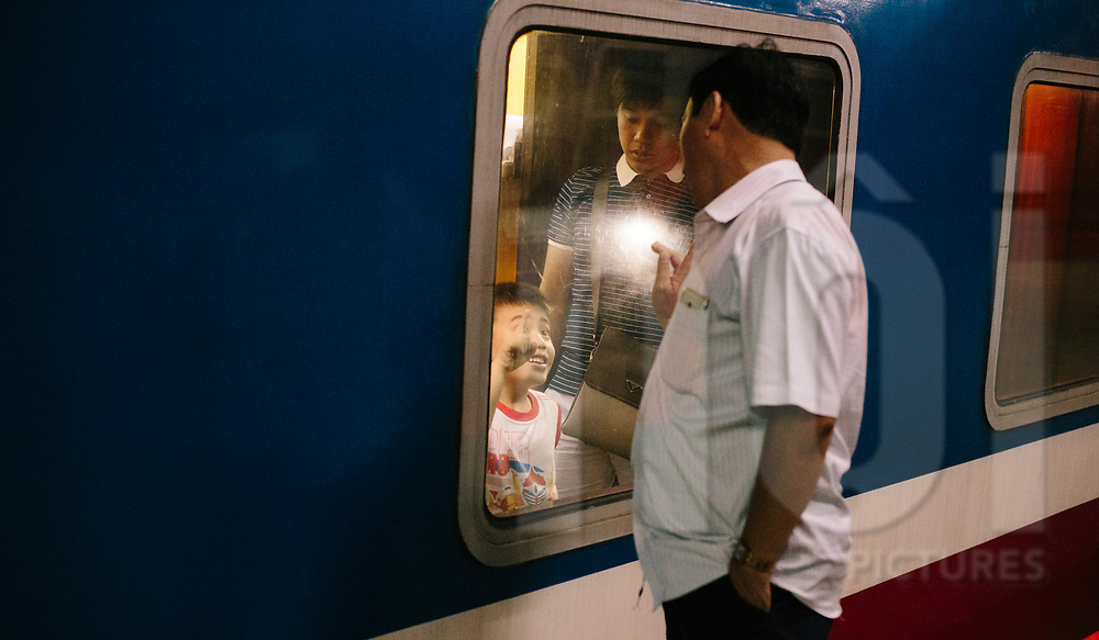 Good bye of a father to his son, Hanoi train station, Vietnam, Southeast Asia