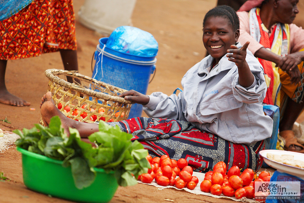 A vendor sits by her produce at Buhongwa market near Mwanza, Tanzania on Monday December 14, 2009.