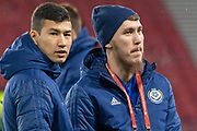 Abat Aymbetov (#17) & Baktiyar Zaynutdinov (#19) of Kazakhstan ahead of the UEFA European 2020 Qualifier match between Scotland and Kazakhstan at Hampden Park, Glasgow, United Kingdom on 19 November 2019.