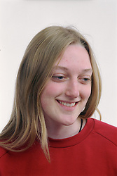 Portrait of teenage girl smiling,