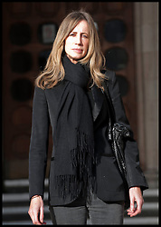 Michelle Young leaves the High Court after the judgement in her divorce case with ex-husband Scott at the High Court, London, United Kingdom. Friday, 22nd November 2013. The wife of tycoon Scot Young has been awarded a £20million divorce settlement but immediately demanded more, branding the judgement 'disgraceful' and her husband a 'powerful maniac' Picture by  i-Images / i-Images