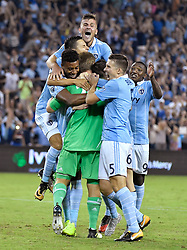 Sporting Kansas City players celebrate their win on penalty kicks over the San Jose Earthquakes during the U.S. Open Cup semifinals at Children's Mercy Park in Kansas City, Kan., on Wednesday, Aug. 9, 2017. Sporting KC advanced on penalty kicks, 5-4, after the teams tied, 1-1, in regulation. (Photo by John Sleezer/Kansas City Star/TNS/Sipa USA) *** Please Use Credit from Credit Field ***