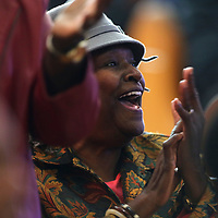 Janice Scales, of Tupelo, applauds as the Lane Chapel Quintet performs at the Community Thanksgiving Service Wednesday morning at Lane Chapel CME Church in Tupelo.