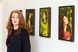 The legendary events and personal tragedies that marked the life of Mary, Queen of Scots will be the subject of a new exhibition in Edinburgh this autumn. Linger Awhile, which will open on 14 September at Arusha Gallery, will include 17 new oil paintings by Glasgow-based artist Helen Flockhart, focusing on the human side of the historical figure.<br /> <br /> Helen Flockhart (b.1963) is one of the finest and most distinctive Scottish artists of her generation. She often draws creative inspiration from esoteric and mythical sources, and her unique style combines intricate patterns, backdrops of lush foliage, and surreal scenes that appear suspended in time.<br /> <br /> Pictured: Helen Flockhart with O Elizabeth, 2018; I see and Keep Silent, 2018; and Crooked Rib, 2018