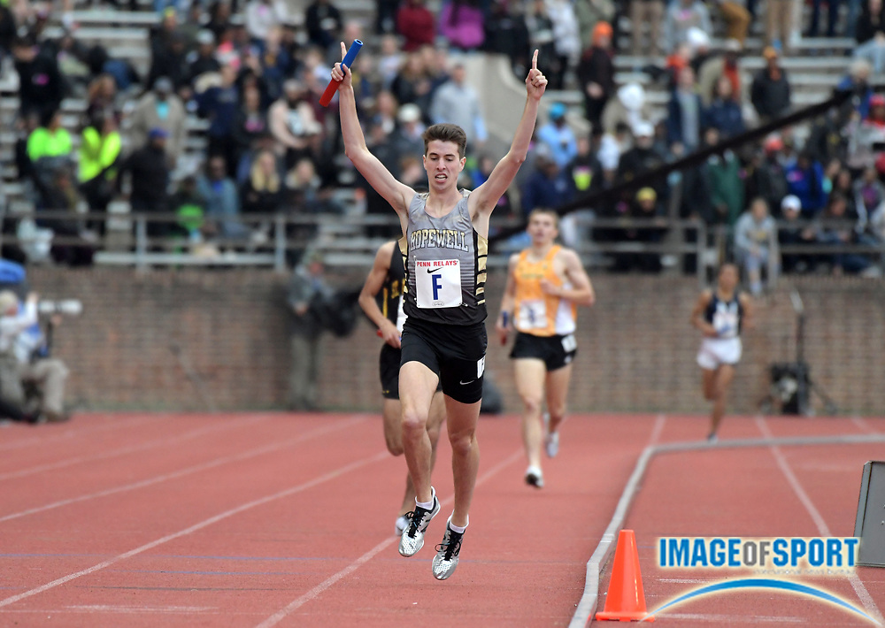 Apr 27, 2018; Philadelphia, PA, USA; Sean Dolan celebrates after running the 1,600m anchor leg on the Hopewell Valley distance medley relay that won the Championship of America race in a meet-record 9:57.55 during the 124th Penn Relays at Franklin Field.