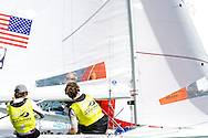 Miami, USA, February 1, 2014 - Stuart McNay and David Hughes earned a bronze medal at the ISAF Sailing World Cup in Miami, finishing behind France and Australia.  The event is part of the qualifying circuit for Olympic hopefuls.  The 470 is the two-person dinghy that will be raced in the 2016 Olympics in Rio de Janeiro.  Pictured here:  rounding the mark.