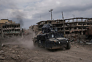 Iraq, Mosul: An Iraqi Federal Police vehicle in an heavily bombarded ara of west Mosul. Alessio Romenzi
