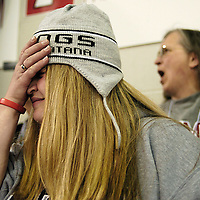 Icedogs fan Lauren Zwiefelhofer buries her face as the Cleveland Barons tie the game 1-1 in the third period, Wednesday in Boardman, Ohio. The Icedogs regained the lead with a goal thirty seconds after the tie, much to the delight of Zwiefelhofer..