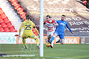 Doncaster Rovers forward John Marquis is foiled by Peterborough Utd defender Jason Naismith (2) early in the second half during the EFL Sky Bet League 1 match between Doncaster Rovers and Peterborough United at the Keepmoat Stadium, Doncaster, England on 9 February 2019.