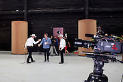 Whip-cracker Chris Camp gives Doug Aitken a five before Station to Station's kick-off at Riverfront Studios in Brooklyn, New York September 6, 2013.
