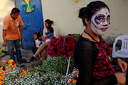 Street vendors sell marigolds on the eve of the Dia del los Muertos celebration.