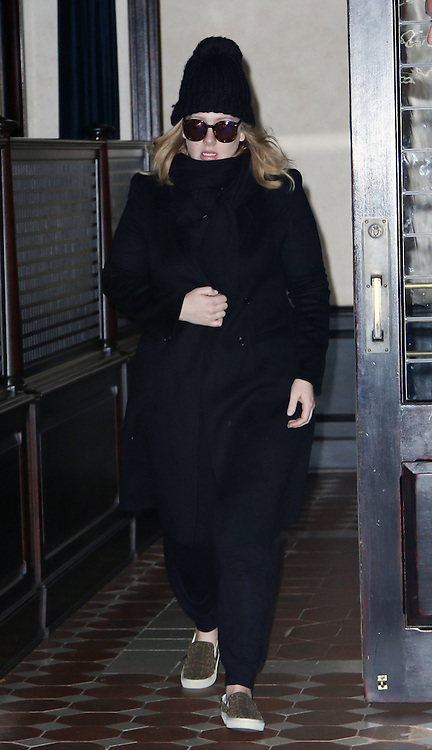Nov. 18, 2015 - New York, NY, USA -<br /> <br /> Singer Adele greets fans as she leaves a downtown hotel<br /> &copy;Exclusivepix Media