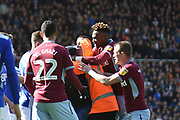 The Aston Villa players struggle with a pitch invader who has just assaulted Aston Villa midfielder Jack Grealish (10) during the EFL Sky Bet Championship match between Birmingham City and Aston Villa at St Andrews, Birmingham, England on 10 March 2019.